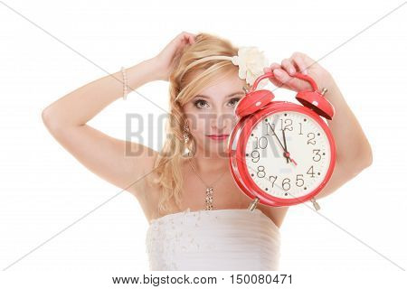 Wedding concept. Time to get married. Unhappy undecided bride with red alarm clock. Beautiful blonde woman waiting for the groom or making decision isolated on white