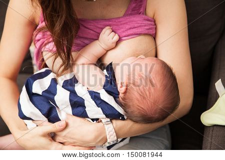 Woman Breastfeeding Her Newborn Baby