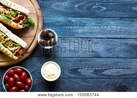 Hot Dog With Pickles, Tomatoes And Olives