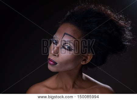 The original make-up on face Afro-American girl