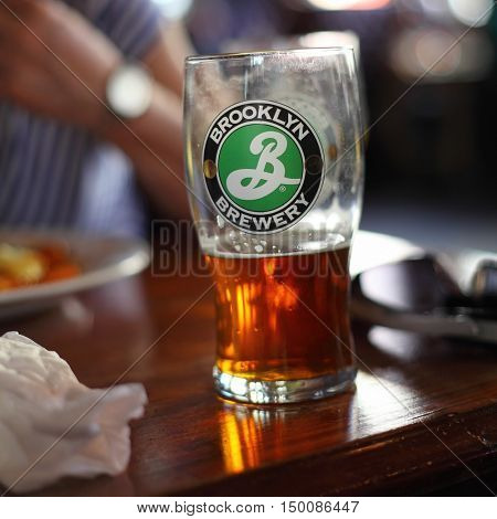 LONDON - MARCH 25:  Half drunk pint of Brooklyn Lager at a Pub on March 25, 2012 in London, UK.