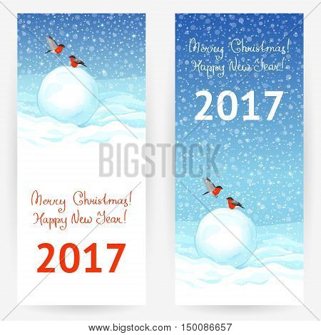 Festive greeting cards with bullfinches, snowballs at snowy background with wishes of a Merry Christmas and a Happy New Year 2017. Vertical banners