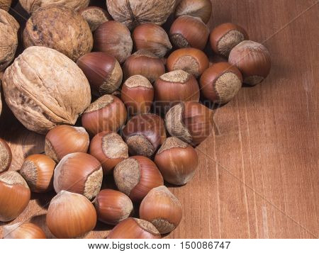 Mix of nuts on wooden background.  Healthy lifestyle.