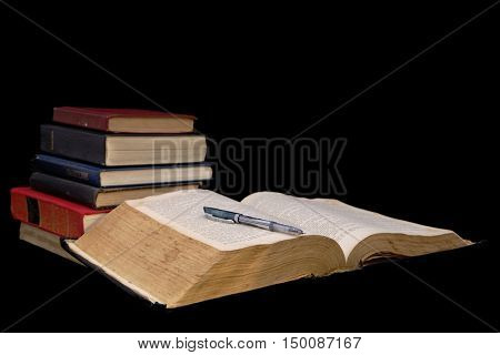 Big open book isolated on a black background