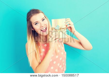 Happy Young Woman Holding A Gift Box