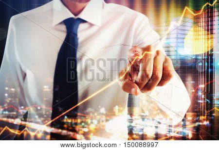Businessman touching a virtual screen of business analysis
