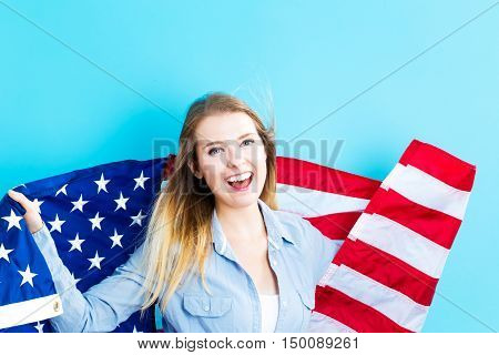Young Traveling Woman Holding American Flag