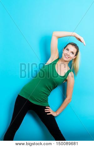 Happy Young Woman Stretching