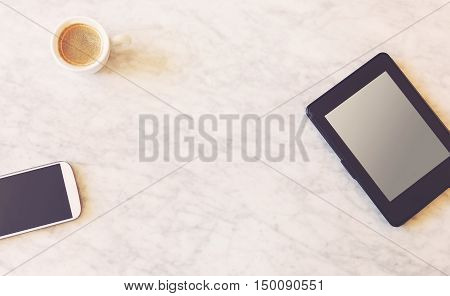 Top down view on digital devices over marble surface with copy space and coffee