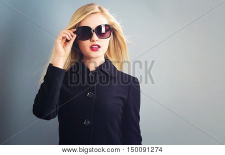 Beautiful Blonde Woman In A Black Coat