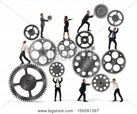 Teamwork of businesspeople work together to a system of gears