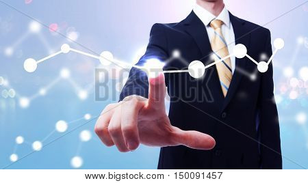 Businessman Interacting With A Digital Graph