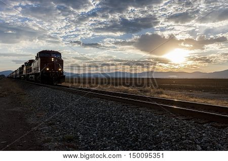 A train moves along on the tracks at sunrise on the Rathdrum Prairie in north Idaho.