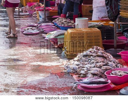 Incheon, South Korean - Sep 23, 2016: Korean woman selling fresh seafood at Incheon Complex Fish Market. The market located at the coastal wharf, which is a major tourist attraction in Incheon City.