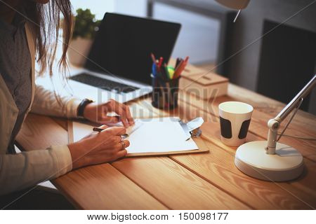 Young female working sitting at a desk