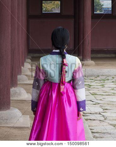 Beautiful girl in Hanbok at Gyeongbokgung, the traditional Korean dress