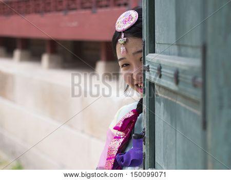 Seoul, South Korea - Sep 26, 2016: Beautiful Korean girl in traditional Hanbok dresses posing at Gyeongbokgung (Gyeongbok) Palace. The palace was the main royal palace of the Joseon dynasty