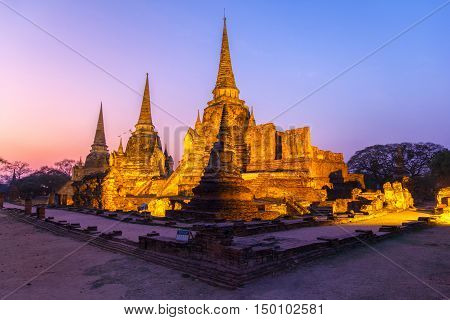 Asian religious architecture. Ancient pagoda at Wat Phra Sri Sanphet temple under twilight sky. Ayutthaya Thailand