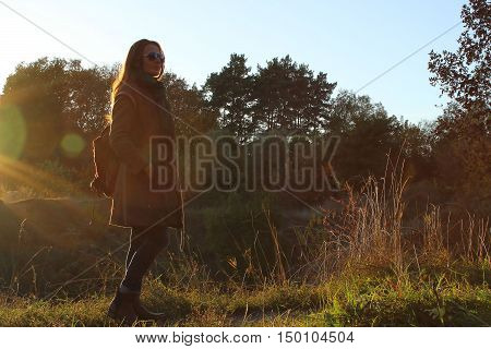 pretty slender young adult woman walking outdoor