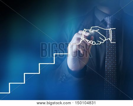 Businessman drawing growing graph