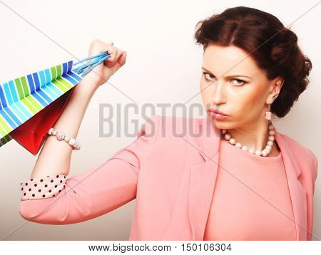 beautiful young woman with colored shopping bags