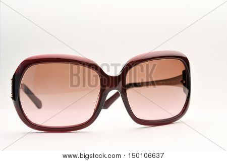 Old sunglass, old style sunglass, red color, on white background, isolated