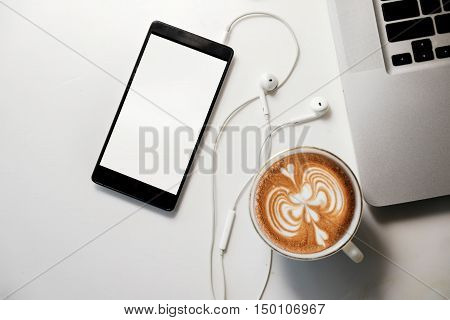 Coffee and smartphone mobile on wood table.