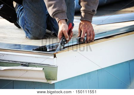 worker working on repairing the damaged roof
