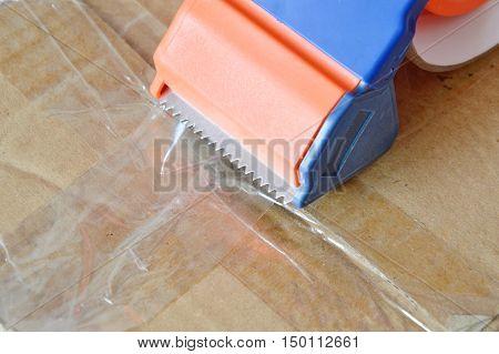 tape disperser seal brown box on for sending
