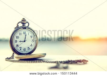 vintage pocket watchon 9 o clock time concept