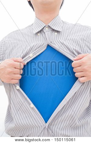 Business man pulling his t-shirt open showing a superhero suit underneath his suit