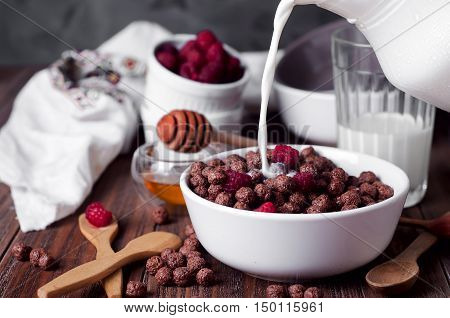 Corn Balls Breakfast With Milk Being Poured Over It