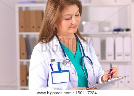 Portrait of happy medical doctor woman in office.