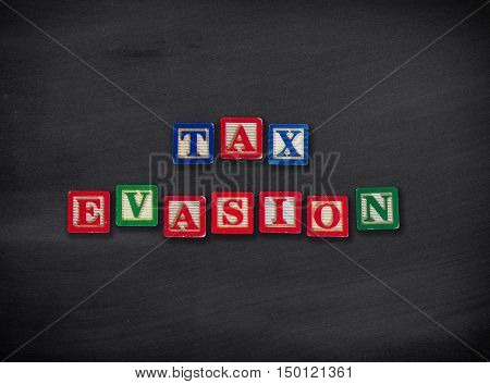 Tax Evasion letter blocks on black chalkboard