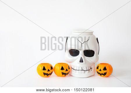 Skull And Orange Jack-o-lantern Pumpkin Buckets In White Isolated Background