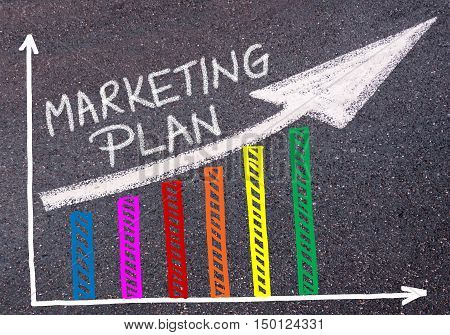 Marketing Plan Written Over Colorful Graph And Rising Arrow