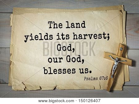 TOP-1000.  Bible verses from Psalms. The land yields its harvest; God, our God, blesses us.