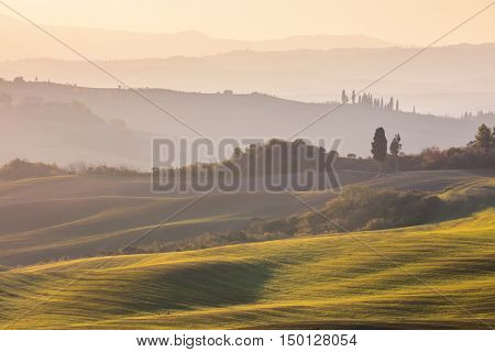 Gentle Autumn landscape - Wavy hills and fields at sunrise, Tuscany, Italy, Europe