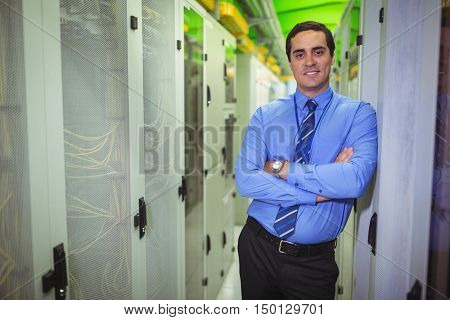 Portrait of technician standing with arms crossed in a server room