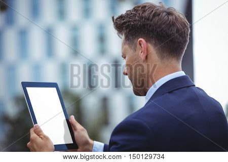 Close-up of businessman using digital tablet