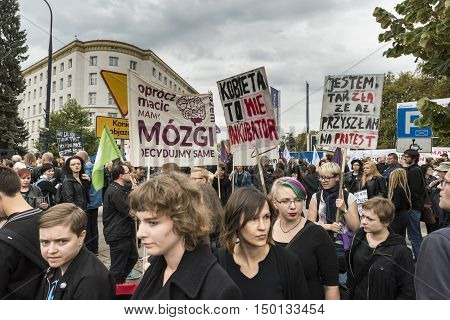 WARSAW POLAND - OCTOBER 01 2016: Polish women donned black (Black Protest) in fron of Polish Parliment protest a legislative proposal for a total ban on abortion.