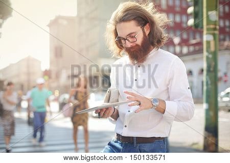 Hipster holding a tablet