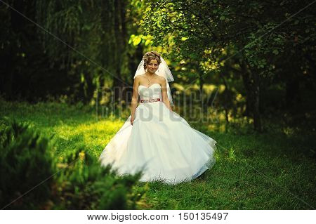 Young blonde bride at the garden at wedding