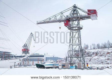 Cranes And Cargo Ships In Wnter Port