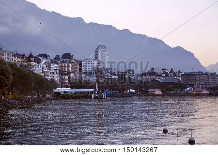 SWITZERLAND, MONTREUX, DECEMBER, 28, 2015 -Wonderful view by a misty morning at sunrise in Montreux ashore the Lake Geneva. Montreux, Switzerland