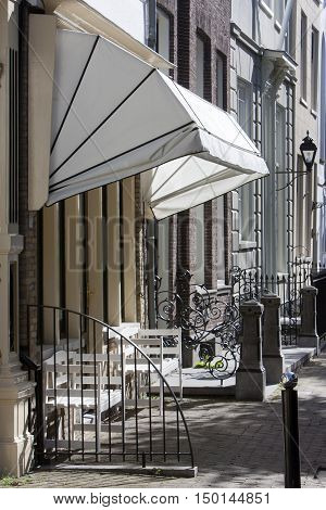 Street with historical buildings and an awning in the city Schoonhoven in the Netherlands