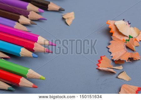 Wooden colorful pencils, on a blue wooden table
