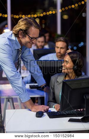 Businessman interacting with his colleague in office at night
