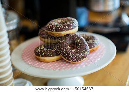 Doughnuts on cake stand in caf\x92\xA9