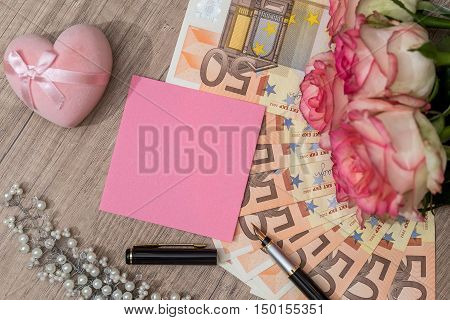 blank with euro and roses in office